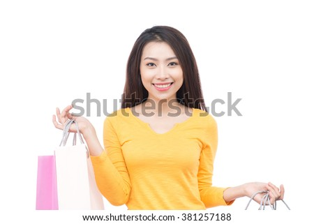 happiness, consumerism, sale and people concept - smiling young woman with shopping bags. beautiful young woman holding colored shopping bags isolated on white background - stock photo