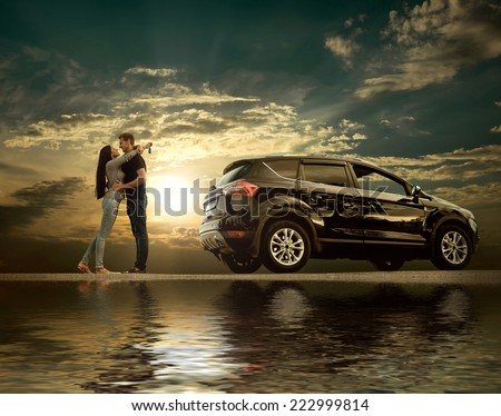 Happiness couple stay near the new car under sky with reflex - stock photo