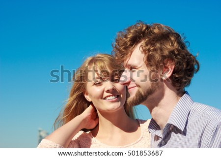 Happiness dating concept. Couple in love blonde woman handsome bearded man enjoy romantic date, outdoor wide angle view