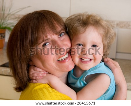 Happiness embracing grandmother with granddaughter
