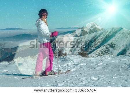 Happiness female at ski stay on the beautiful mountains view - stock photo