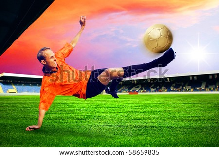 Happiness football player after goal on the field of stadium with blue sky - stock photo