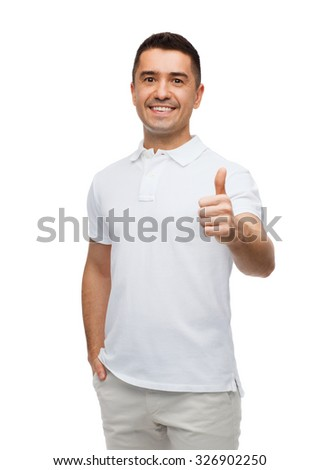 happiness, gesture and people concept - smiling man showing thumbs up - stock photo