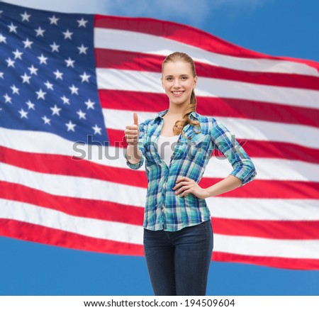 happiness, gesutre and people concept - smiling young woman in casual clothes showing thumbs up