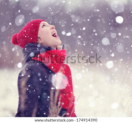 happiness, girl catches snowflakes mouth - stock photo