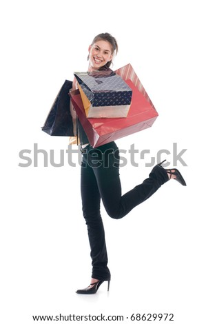 Happiness girl holding paper bags on shoulders and standing on one legs - stock photo