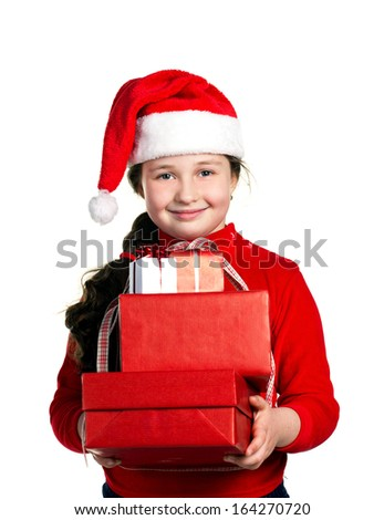 happiness girl in santa hat and red dress with red present boxes on white background - stock photo