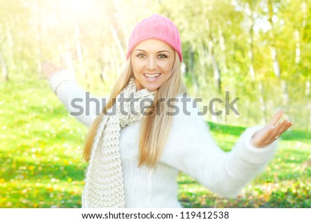Happiness girl with open hands enjoyment nature at beautiful sunny day.