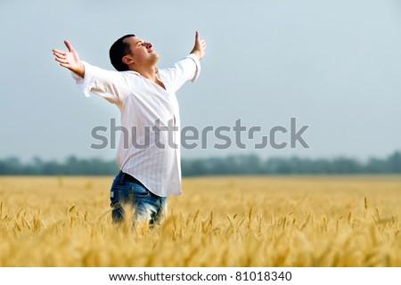 Happiness in golden summer corn field - stock photo