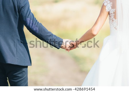 happiness is in your hands. Happy couple holding hands
