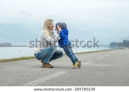 Happiness Mother and son funning outdoor - stock photo