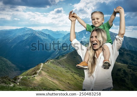 Happiness Mother and son on the Beautiful view of the mountains - stock photo