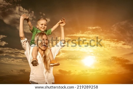 Happiness Mother and son under Beautiful sky - stock photo