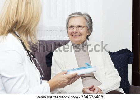 Happiness senior women sitting on the sofa and talking with her home caregiver. - stock photo