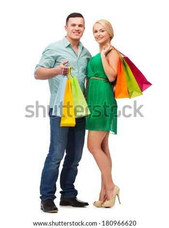 happiness, shopping and couple concept - smiling couple with shopping bags - stock photo