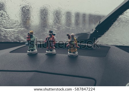 Happiness, wealth and longevity symbols on car dashboard
