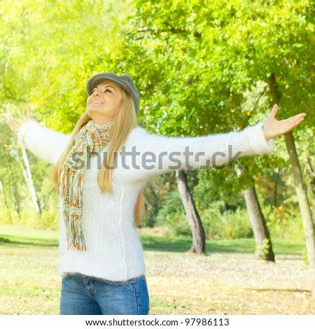 Happiness woman with raised hands enjoying in the nature.