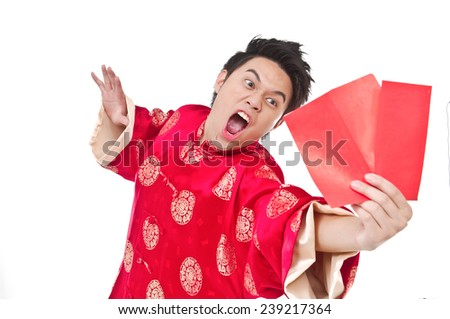 Happing chinese young man. Chinese new year. In Chinese, a red packet is a monetary gift - stock photo