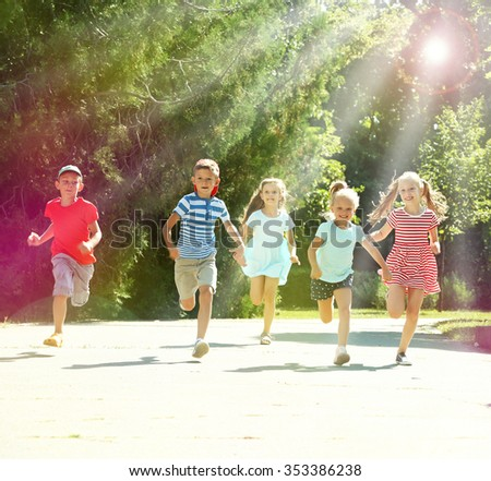 Happy active children running in park - stock photo
