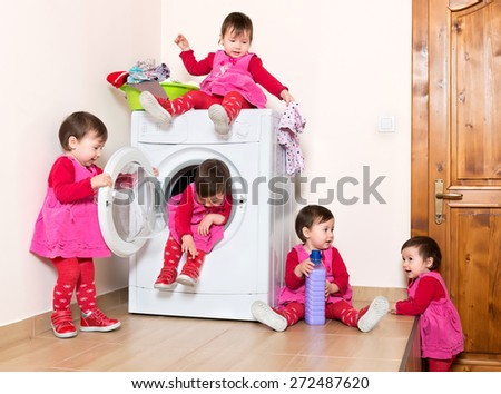 Happy actuve little child using washing machine at bathe - stock photo