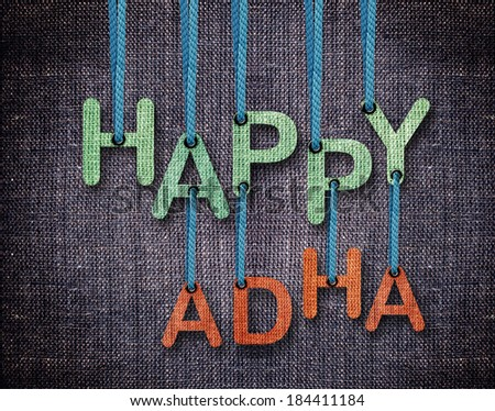 Happy Adha Letters hanging strings with blue sackcloth background. - stock photo