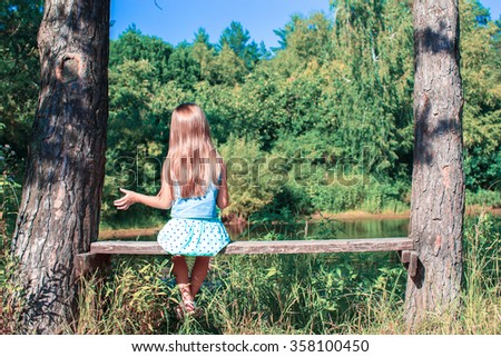 Happy adorable little girl enjoy summer day outdoors - stock photo