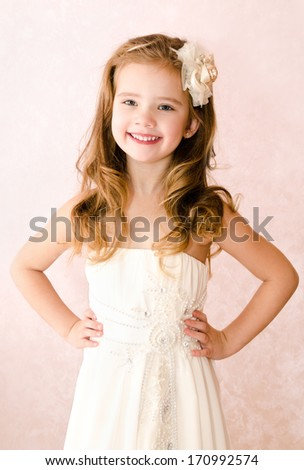 Happy adorable little girl in princess dress isolated - stock photo
