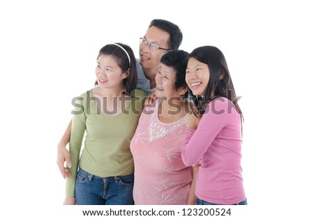 happy adult asian family looking at somewhere - stock photo