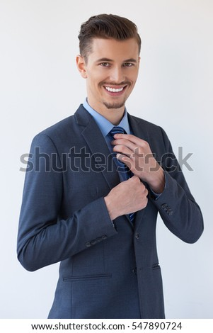Happy Adult Elegant Business Leader Adjusting Tie