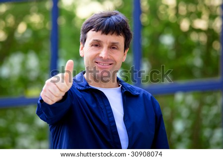 Happy adult fashionable man showing sign allright - stock photo