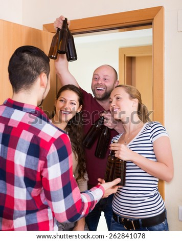 Happy adult friends gathering together at house booze party - stock photo