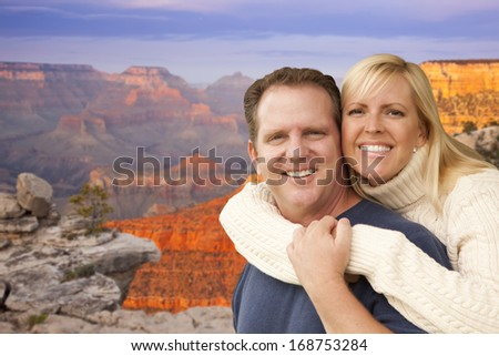 Happy Affectionate Couple at the Grand Canyon Lookout Point. - stock photo