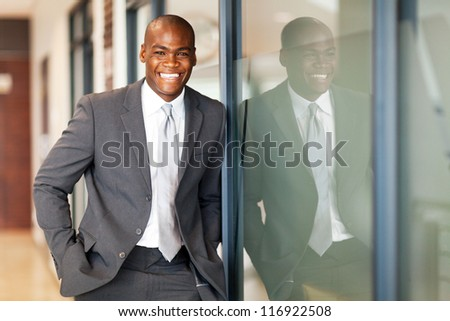 happy african american business executive portrait in office - stock photo
