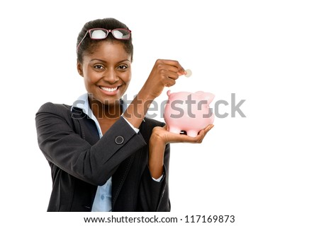 Happy African American business woman holding piggybank isolated on white background