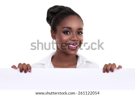 Happy African American business woman holding sign or banner isolated on white - stock photo