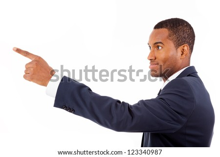 Happy African American businessman pointing at copy space against white background