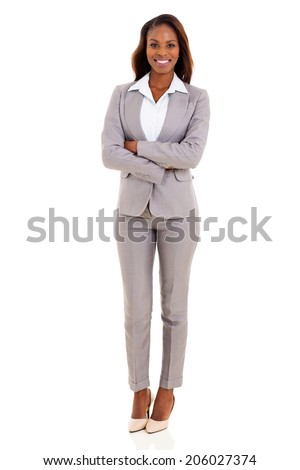 happy african american businesswoman with arms crossed - stock photo