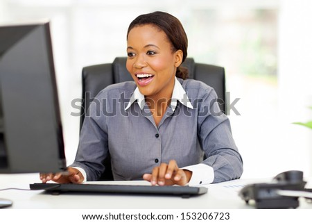 happy african american businesswoman working in modern office