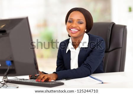 happy african american businesswoman working in office - stock photo