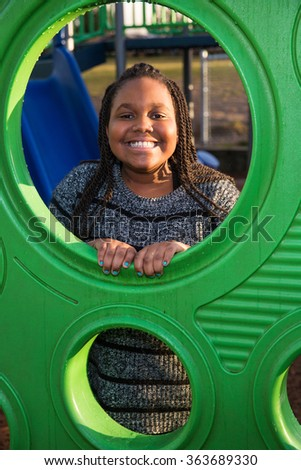 Happy African American child playing outside - stock photo
