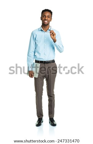 Happy african american college student standing with laptop on white background - stock photo