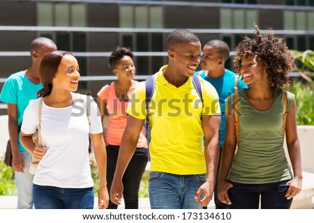 happy african american college students walking together on campus - stock photo
