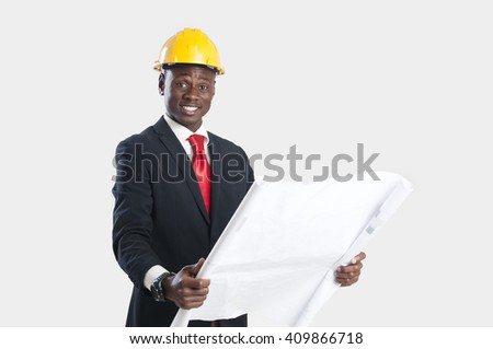 Happy african american construction worker holding blueprints isolated on white. - stock photo