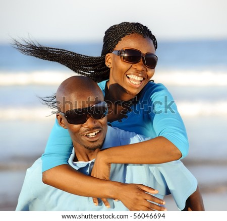 Happy African American couple enjoy the beach - stock photo