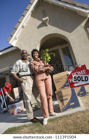 Happy African American couple moving to their new house - stock photo