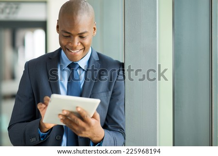 happy african american entrepreneur using tablet computer - stock photo