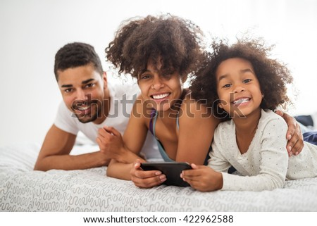 Happy african american family enjoying time together. - stock photo