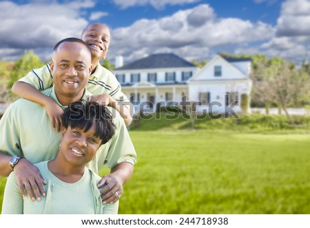 Happy African American Family In Front of Beautiful House. - stock photo