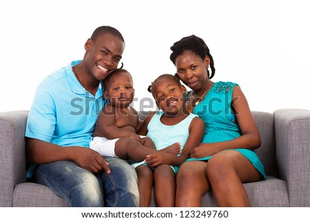 happy african american family sitting on sofa - stock photo
