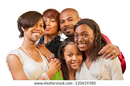 Happy African American family with teenage kids smiling on white background. Shallow DOF, focus on children. - stock photo